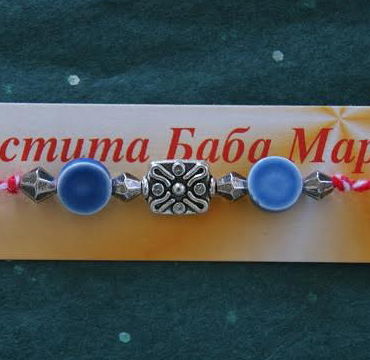 Bulgarian martenitsa bracelet with 3 lucky charms