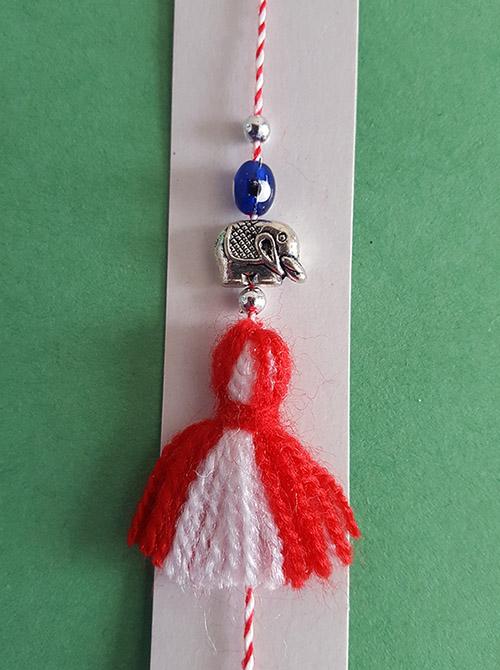 martenitsa bracelet with elephant and blue bead