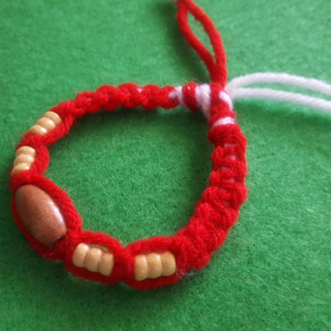 knit bracelet martenitsa with wooden beads