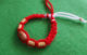 knit bracelet martenitsa with wooden beads