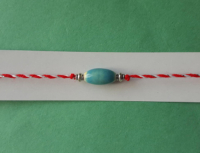 thin martenitsa bracelet with blue charm