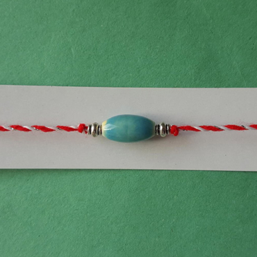 thin martenitsa bracelet with blue charm