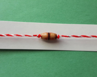 thin martenitsa bracelet with wooden charm